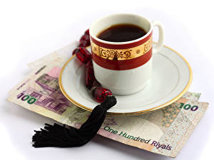 Fotos Kaffee Geld Banknoten Weißer hintergrund Tasse Untertasse