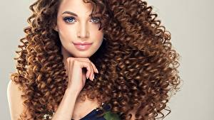Images Curly Brown haired Staring Hands Hairdo Hair young woman