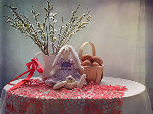 Picture Easter Still-life Table Branches Wicker basket Eggs Doll Bow Food
