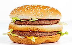Fotos Fast food Hamburger Brötchen Frikadelle Nahaufnahme Weißer hintergrund Lebensmittel