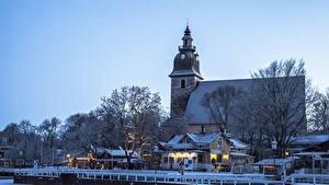 Desktop hintergrundbilder Finnland Winter Neujahr Haus Schiffsanleger Abend Naantali Städte