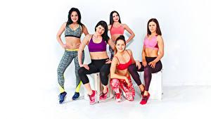 Hintergrundbilder Fitness Sitzen Brünette Braune Haare Lächeln Starren 5 Sport Mädchens