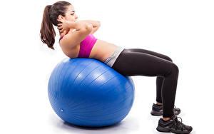 Bilder Fitness Ball Blau Braune Haare Bein Weißer hintergrund Körperliche Aktivität junge frau Sport