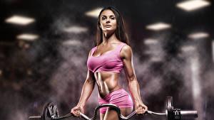Bilder Fitness Bokeh Braunhaarige Hantelstange Muskeln Bauch junge frau Sport