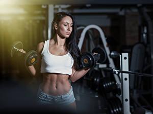 Fotos Fitness Brünette Bokeh Bauch Hand Hanteln Shorts Mädchens