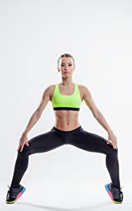 Fotos Fitness Weißer hintergrund Bauch Hand Mädchens Sport