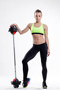 Fotos Fitness Weißer hintergrund Braune Haare Hantelstange Bauch Mädchens Sport