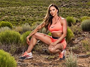 Fotos Fitness Bein Sitzt Sportschuhe nike Mädchens