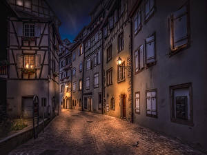 Pictures France Building Street Night time Street lights Colmar Cities