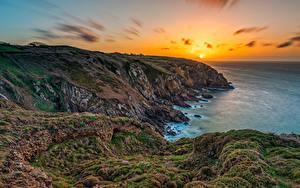 Bilder Frankreich Morgendämmerung und Sonnenuntergang Küste Felsen Laubmoose Sonne Brittany