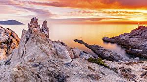 Bilder Frankreich Morgendämmerung und Sonnenuntergang Küste Bucht Felsen Calvi Corse Natur