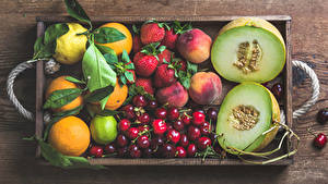 Bilder Obst Melone Orange Frucht Kirsche Erdbeeren Zitrone Limette