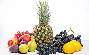 Fotos Obst Ananas Weintraube Zitronen Birnen Echte Feige Äpfel Weißer hintergrund Lebensmittel