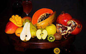 Image Fruit Pomegranate Pears Kiwifruit Apples Pumpkin Black background Food