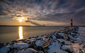 Wallpapers Germany Coast Lighthouses Stones Sunrise and sunset