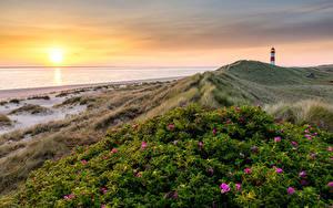 Bilder Deutschland Küste Leuchtturm Morgendämmerung und Sonnenuntergang Landschaftsfotografie Sonne Ellenbogen