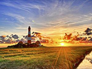 Fotos Deutschland Sonnenaufgänge und Sonnenuntergänge Leuchtturm Himmel Landschaftsfotografie Gras Sonne Lichtstrahl Vesterhever