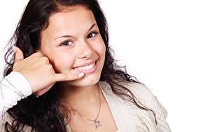 Fotos Gestik Brünette Weißer hintergrund Starren Lächeln Hand Gesicht junge frau