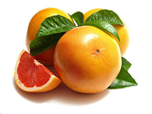 Bilder Grapefruit Großansicht Weißer hintergrund Blattwerk das Essen