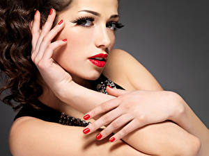 Picture Gray background Brown haired Face Red lips Hands Manicure Makeup Beautiful Girls