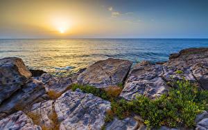 Fotos Griechenland Landschaftsfotografie Sonnenaufgänge und Sonnenuntergänge Steine Meer Sonne Crete