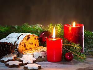 Fotos Feiertage Neujahr Backware Kerzen Kekse Keks Rosinen Ast