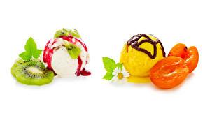 Fotos Speiseeis Marille Kiwifrucht Schokolade Kamillen Weißer hintergrund Kugeln