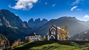 Bilder Italien Gebirge Kirchengebäude Himmel Alpen Falcade Natur
