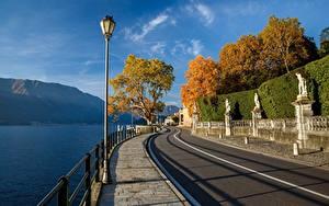 Bilder Italien Gebirge See Alpen Waterfront Bäume Straßenlaterne Lago di Como Natur