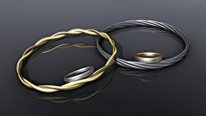 Bilder Schmuck Armband Grauer Hintergrund Schmuck Ring 3D-Grafik