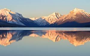 Bilder See Gebirge Park Vereinigte Staaten Spiegelung Spiegelbild Schnee Montana, Lake McDonald, Glacier national Park Natur
