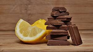 Desktop hintergrundbilder Zitrone Schokolade Stück Lebensmittel