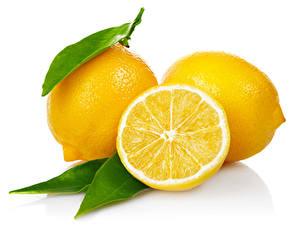 Fotos Zitrone Großansicht Weißer hintergrund Lebensmittel