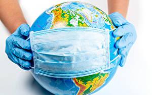Bilder Maske Coronavirus Weißer hintergrund Globus Hand Handschuh