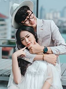 Wallpaper Men Lovers Asiatic Two Hugging Hat Glasses Smile Brunette girl Hands Guy Girls