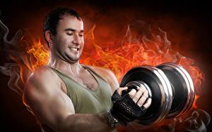 Fotos Mann Feuer Hantel Muskeln sportliches