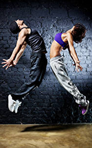 Photo Man Two Dancing Hands Brown haired Jump young woman