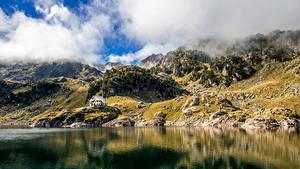 Fotos Berg See Steine Wolke Felsen
