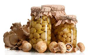 Bilder Pilze Weißer hintergrund Weckglas Lebensmittel