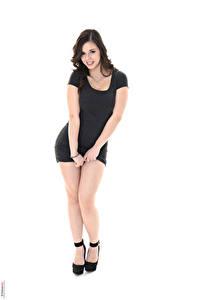 Bilder Nekane Sweet iStripper Weißer hintergrund Brünette Lächeln Posiert Kleid Hand Bein High Heels junge frau