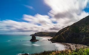 Desktop hintergrundbilder Neuseeland Küste Felsen Wolke Piha Beach Natur