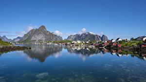 Fotos Norwegen Lofoten Gebirge Haus Reflexion Bucht Reine