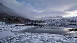 Bilder Norwegen Berg Lofoten Wolke Eis