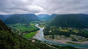 Desktop hintergrundbilder Norwegen Berg Flusse Straße Wolke Von oben Trollveggen Natur