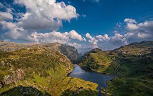 Bilder Norwegen Berg Himmel Felsen Wolke Hardangerfjord