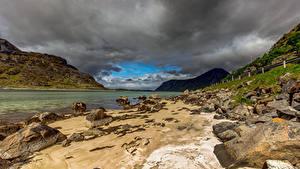Bilder Norwegen Berg Steine Wolke Uttakleiv beach