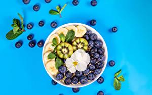 Hintergrundbilder Haferbrei Heidelbeeren Obst Kiwifrucht Farbigen hintergrund das Essen