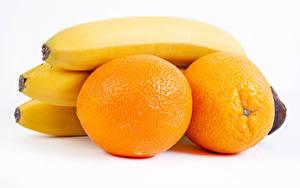 Bilder Apfelsine Bananen Weißer hintergrund das Essen