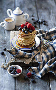 Pictures Pancake Berry Raspberry Blueberries Wood planks Fork Food