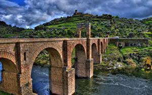 Hintergrundbilder Fluss Brücken Spanien Hügel HDR Alcantara Bridge, Tagus river, province Caceres